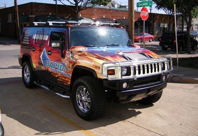 vinyl graphics Wrap installed on a Hummer H2 for Rapid Industrial Cleaning
